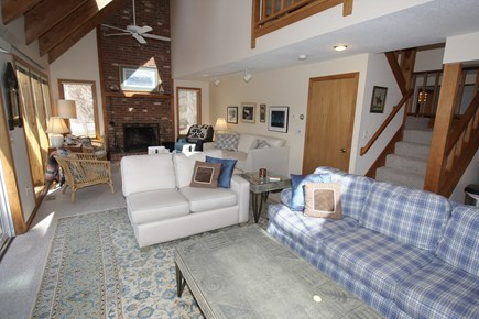 Brewster Cape Cod vacation rental - Cozy living room with additional seating by the fireplace
