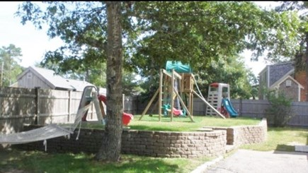 South Yarmouth Cape Cod vacation rental - Back yard with swingset