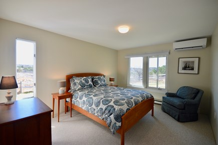 Truro Cape Cod vacation rental - Lower bedroom 1 with queen bed and mini split A/C