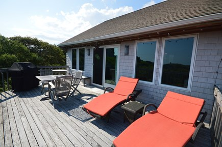 Truro Cape Cod vacation rental - Spacious deck with lounge furniture, outdoor dining table, grill