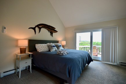 Truro Cape Cod vacation rental - Master bedroom with king bed, en suite full bath and private deck