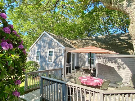 Hyannis Cape Cod vacation rental - Spacious patio with table, chairs, and charcoal grill.