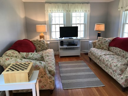 Orleans Cape Cod vacation rental - TV room has two couches and a variety of DVDs to watch.