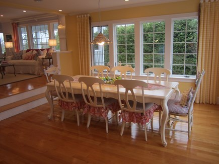 North Chatham Cape Cod vacation rental - Dining room with seating for 8+ and McKenzie Childs fish chairs.