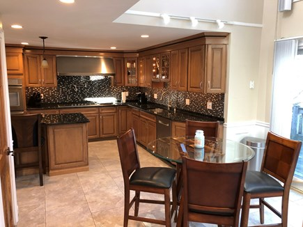 East Falmouth Cape Cod vacation rental - Kitchen and nook area looking out onto water