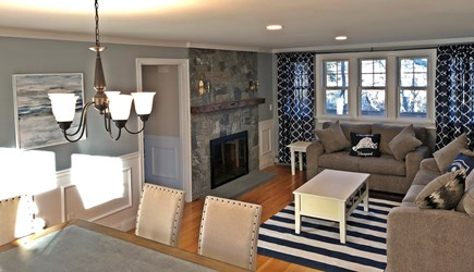 East Falmouth Cape Cod vacation rental - Open living and dining area with fireplace