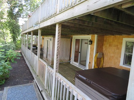 East Falmouth Cape Cod vacation rental - Lower deck with sauna, Jacuzzi and additional table and chairs