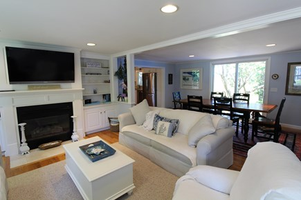 Harwich Port Cape Cod vacation rental - Living area with gas fire place and plat screen.