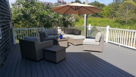 Eastham Cape Cod vacation rental - Furnished deck with dining area and outdoor shower