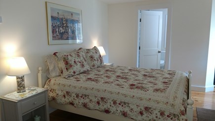 Dennisport Cape Cod vacation rental - Master bedroom with queen bed, en suite bath (tub & shower) & A/C