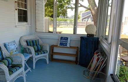 Dennisport Cape Cod vacation rental - Enjoy summer breezes on the enclosed porch