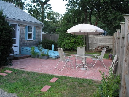Harwich Port Cape Cod vacation rental - Extra chairs for Patio in the storage box around back.