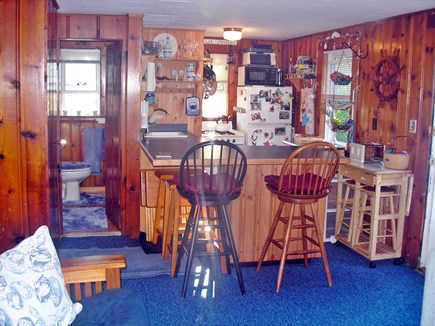 Harwich Port Cape Cod vacation rental - Kitchen, Bar and Bath 1 (from living area)