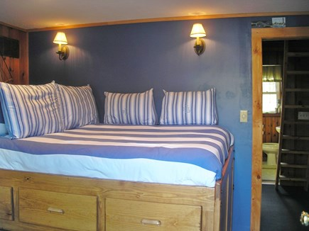 Harwich Port Cape Cod vacation rental - Master bed is raised to allow for storage under. Bath 2 in back.