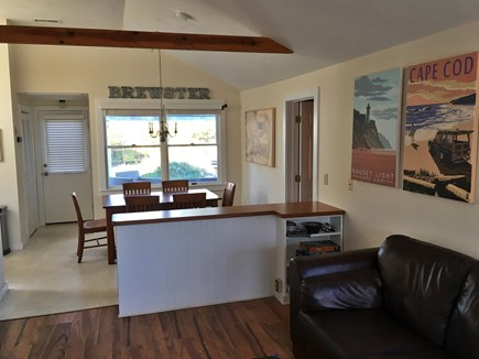 Brewster Cape Cod vacation rental - Living Area - open to dining area and view of back deck.
