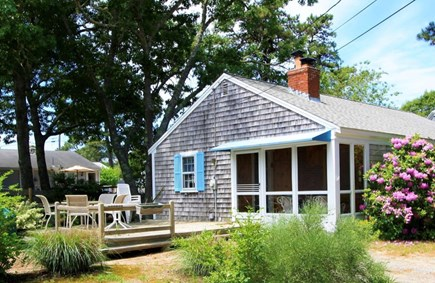 West Dennis Cape Cod vacation rental - Large deck and lower patio includes grill and sizable yard