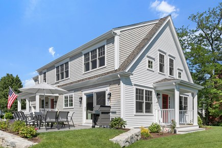 Dennis, Mayflower Beach Cape Cod vacation rental - Front of house with large eat out side patio with gas grill