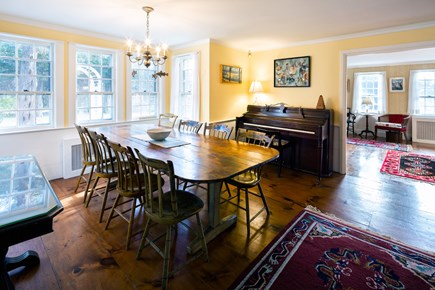 Orleans Cape Cod vacation rental - Stately dining table and vintage piano
