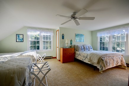 Orleans Cape Cod vacation rental - Upper level bedroom with queen and 2 twins, ceiling fan and AC