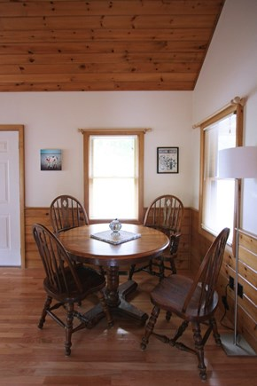 Provincetown Cape Cod vacation rental - Sturdy captain's table and chairs in the dining area.