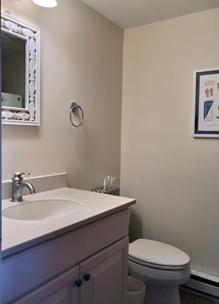 Chatham  Cape Cod vacation rental - First floor bathroom with shower and stacked washer/dryer.