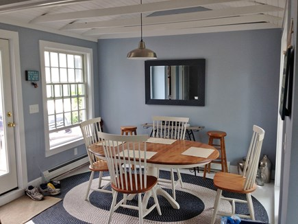 Provincetown Cape Cod vacation rental - Breezeway dining table with 4 chairs.  Extra seating available.