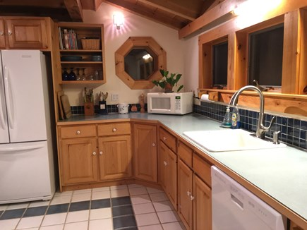 Truro Cape Cod vacation rental - Open spacious kitchen with skylights and gas range.