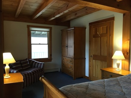 Truro Cape Cod vacation rental - Roomy 1st floor bedroom with queen bed and sofa.