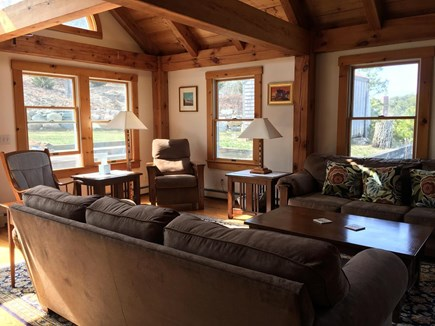 Truro Cape Cod vacation rental - Bright and open living room area with access to the backyard.
