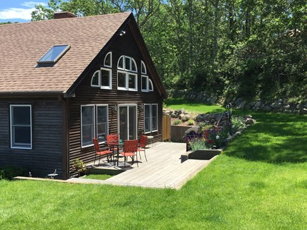 Truro Cape Cod vacation rental - Private back yard deck with access to outdoor shower and lawn.
