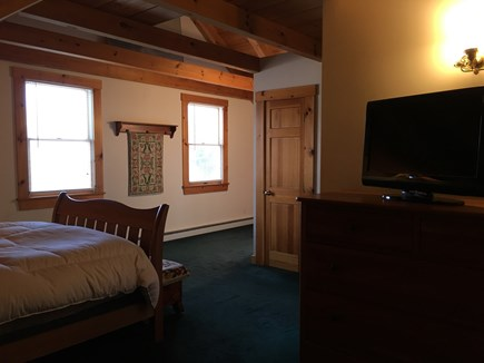 Truro Cape Cod vacation rental - Master bed room with queen bed and tv.