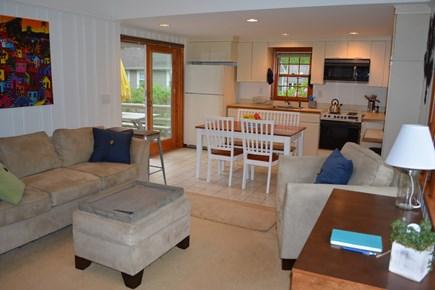 New Seabury / Popponesset New Seabury vacation rental - LR open to kitchen w sliding glass door to deck & outdoor dining
