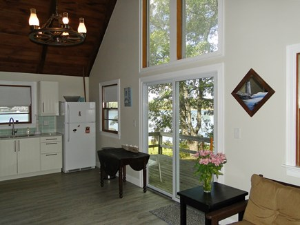 Onset, Buzzards Bay MA vacation rental - Living room opens to kitchen and slider to deck, water views