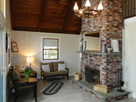 Onset, Buzzards Bay MA vacation rental - Vaulted living room with fireplace, new floors