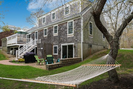 West Yarmouth Cape Cod vacation rental - Beautifully landscaped yard with patio and deck.