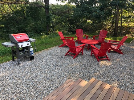 Truro Cape Cod vacation rental - Back yard lounging and bbq patio