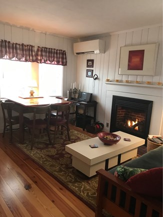 Wellfleet Cape Cod vacation rental - Open living - dining  with a bay view and fire place.