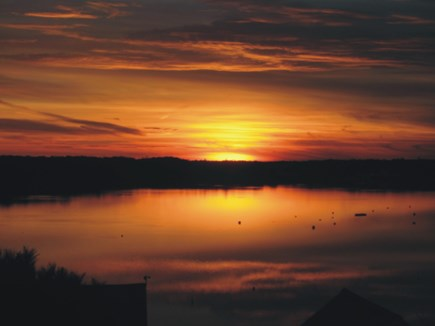 Chatham Cape Cod vacation rental - View from the deck as the sun sets over the Oyster Pond