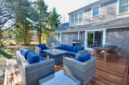 Orleans Cape Cod vacation rental - Large, private backyard with new deck, dining and fire pit