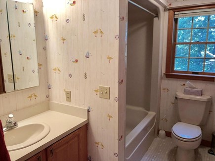Eastham Cape Cod vacation rental - 1st Floor Main Bathroom - tub/shower.  Laundry area in this bath