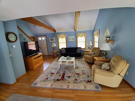 Eastham Cape Cod vacation rental - Spacious living room with vaulted ceiling.