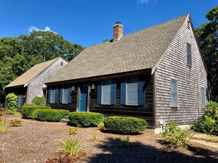 Eastham Cape Cod vacation rental - Front of house-traditional Cape outside, but nice and open inside