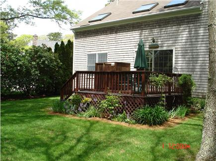 East Falmouth Cape Cod vacation rental - Backyard with outside shower and gas grill