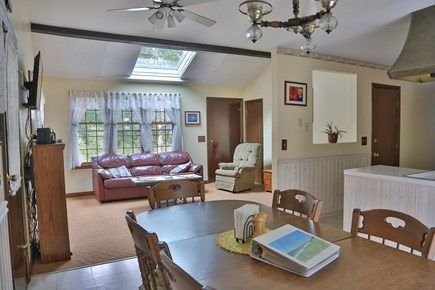 Eastham Cape Cod vacation rental - Dining room area looking into open living room.
