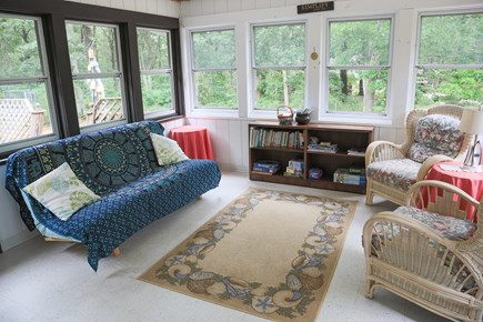 Eastham Cape Cod vacation rental - Relaxing sun room with futon and comfortable reading chairs.