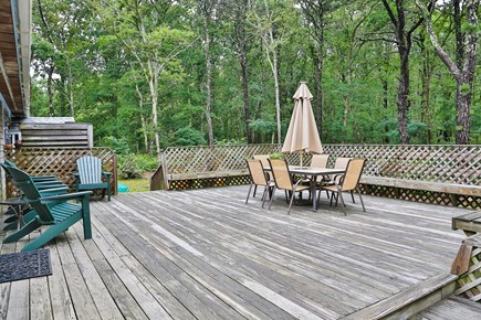 Eastham Cape Cod vacation rental - Private back deck area with patio table and chairs.