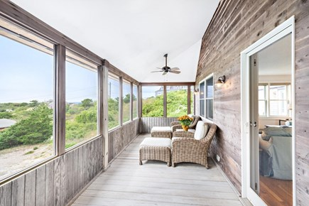 Truro Cape Cod vacation rental - Screened porch with 2 ceiling fans off of living room.