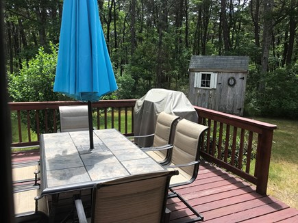 West Yarmouth Cape Cod vacation rental - Inviting backyard deck with grille and table and chairs