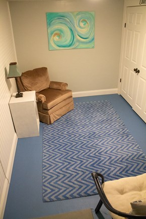 Hyannis Cape Cod vacation rental - Downstairs laundry room and cozy area to read a book