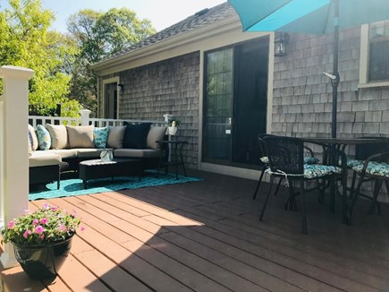 Hyannis Cape Cod vacation rental - Cozy deck seating area & a shaded place to eat.
